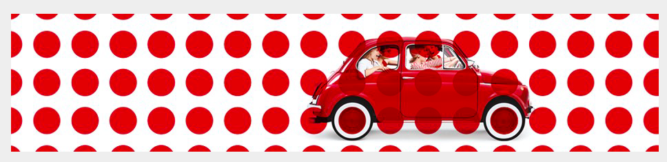 Red car on a pola dot background